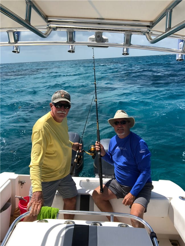 Photo client of enright charter on boat with captain George